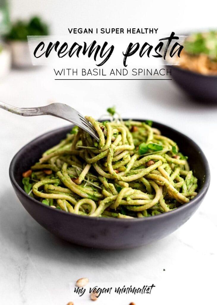 A bowl of green pasta.