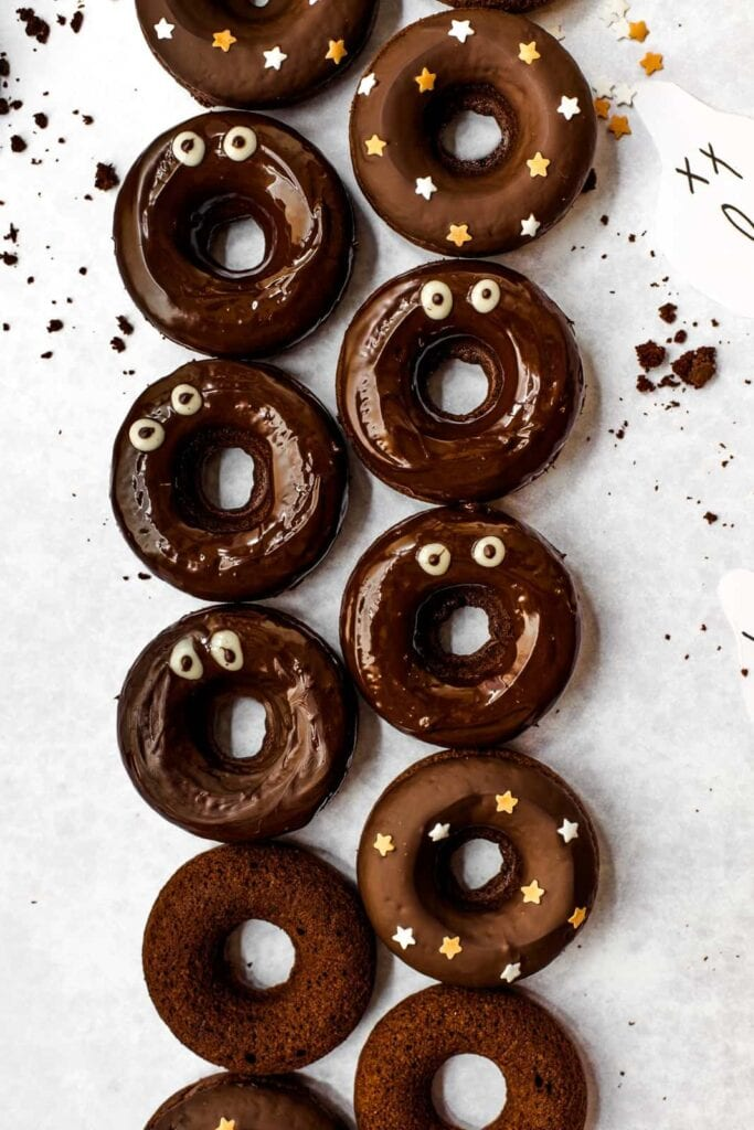 Chocolate donuts decorated with goggly eye