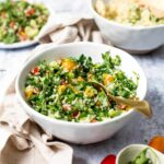 Side view of tabbouleh salad in a large white bowl.