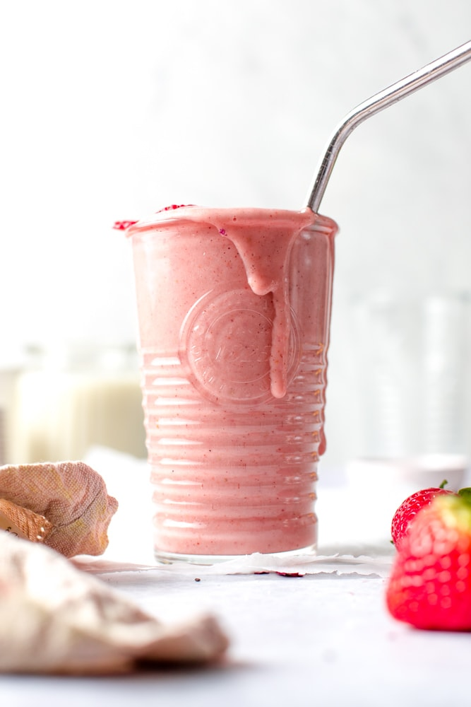 A full glass of pink smoothie.