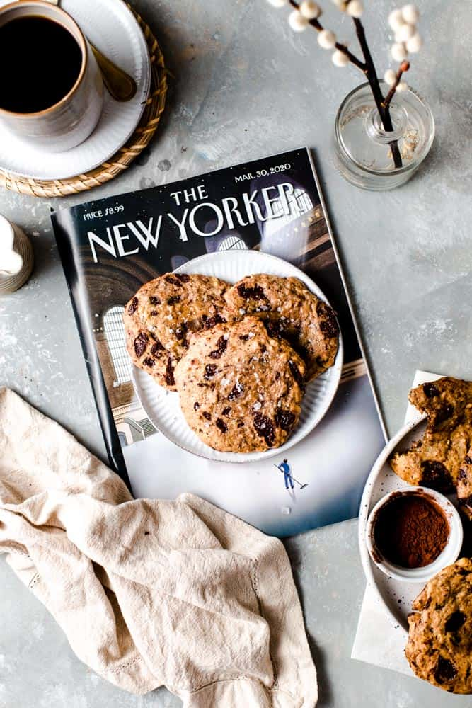 A plate of cookies placed on top of the New Yorker magazine.