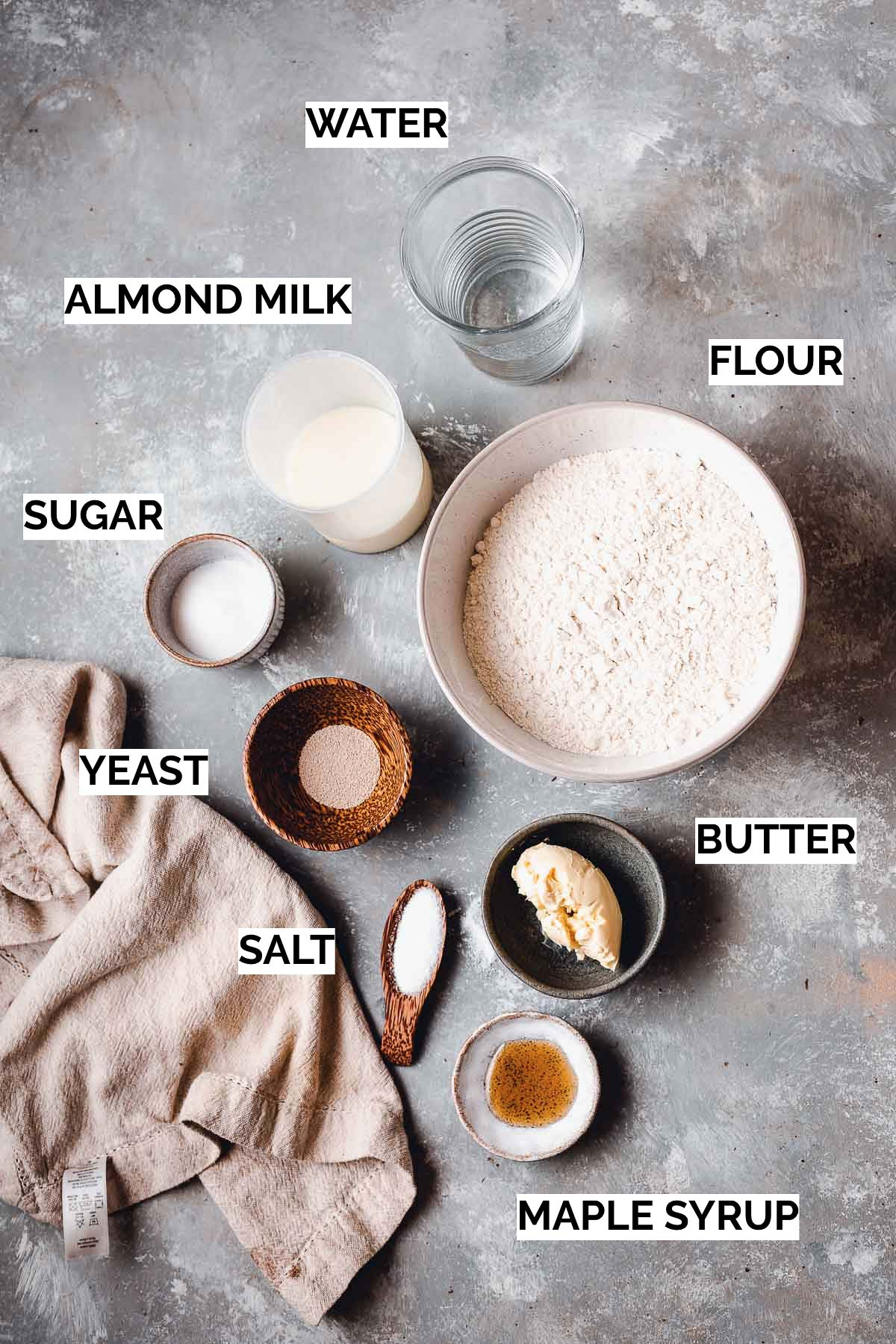 All ingredients needed to make a dinner roll laid out.