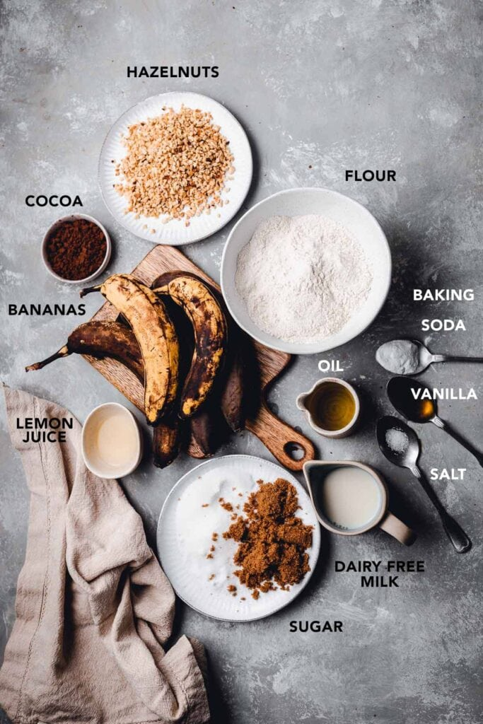 All ingredients needed to make vegan banana bread laid out on a flat surface.