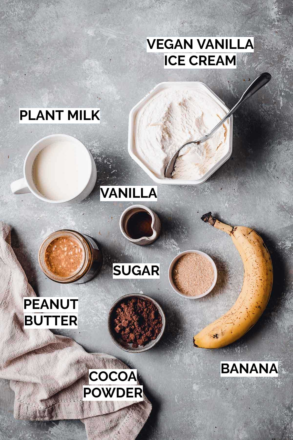 All ingredients needed to make a chocolate shake laid out on a flat surface.