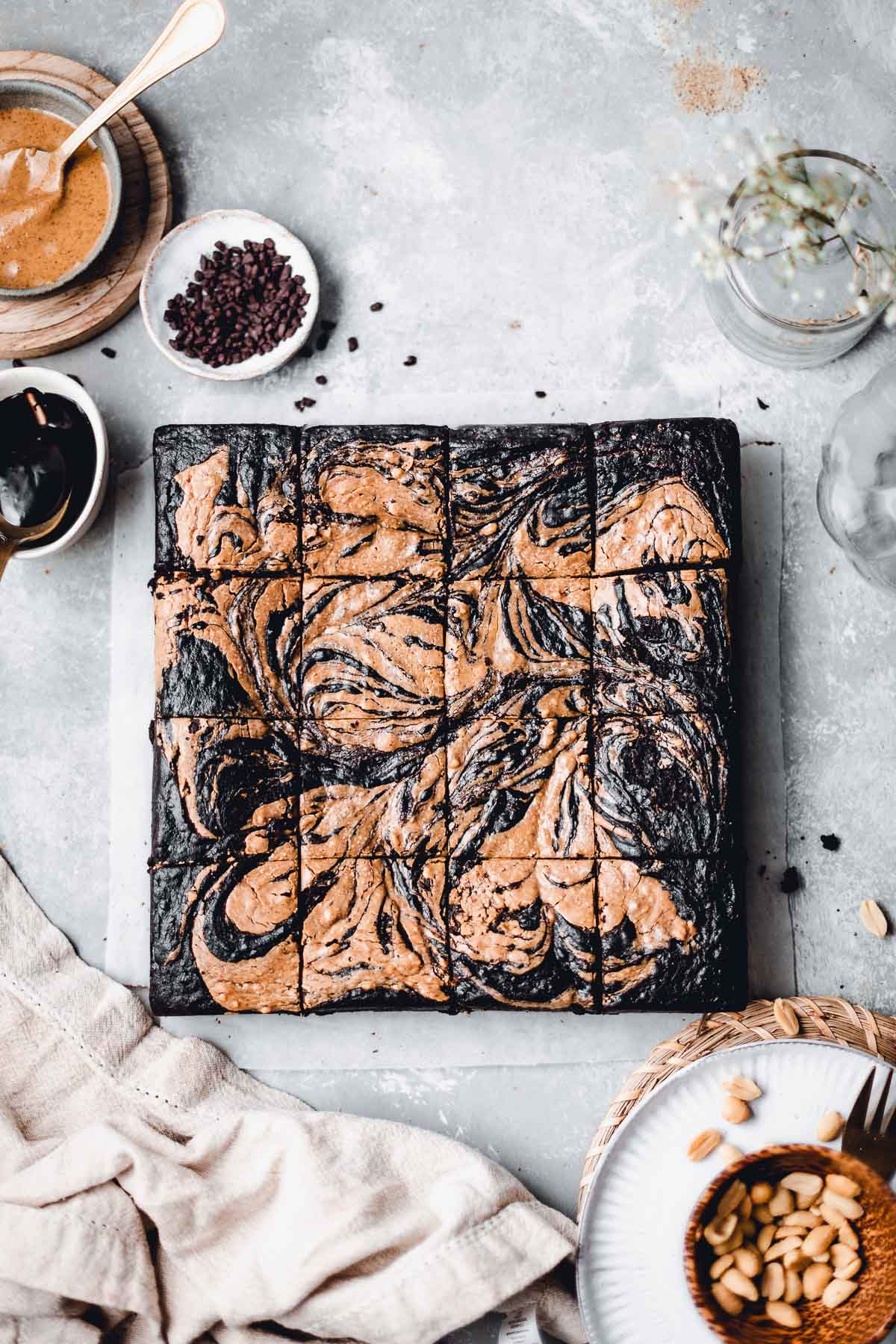 An overhead view of chocolate brownie cut into 16 equal pieces.