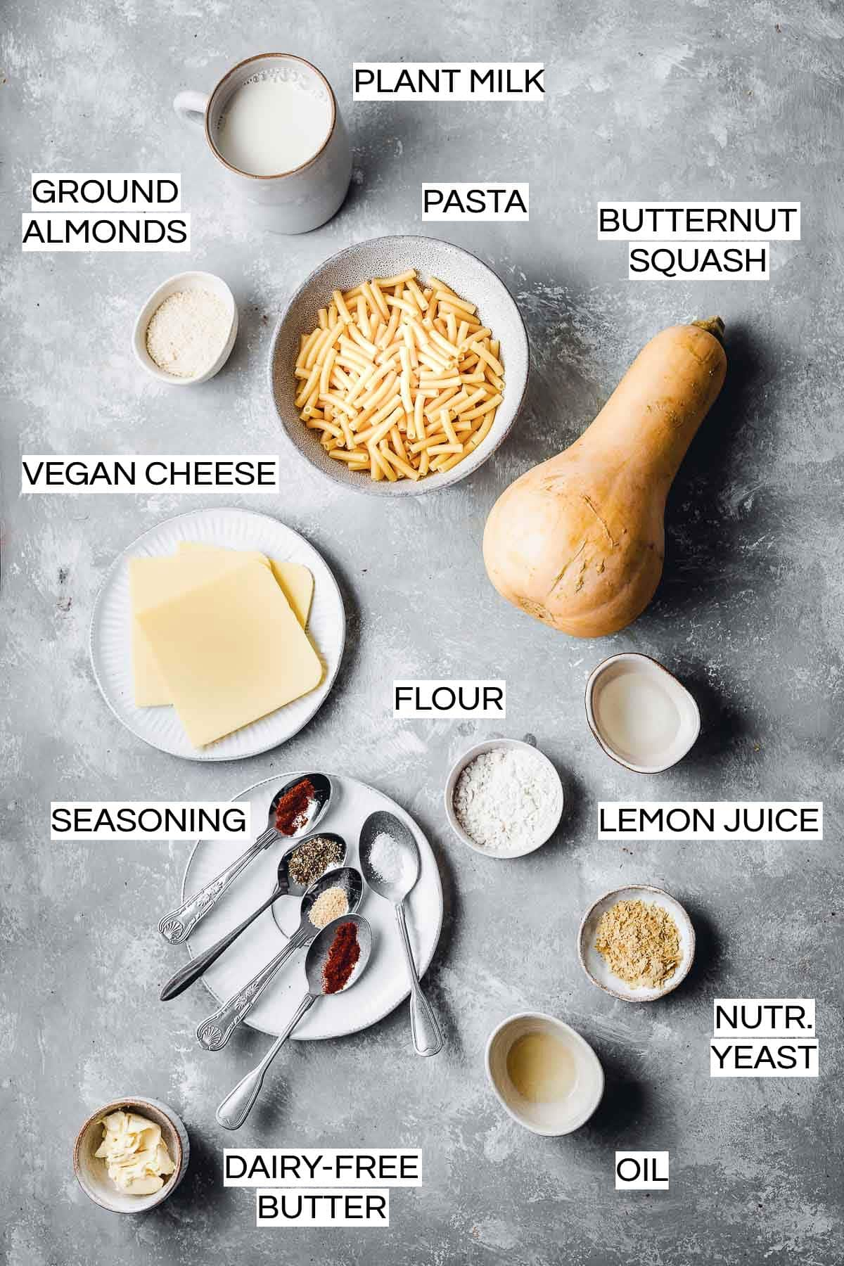 All ingredients needed to make baked vegan mac and cheese laid out on a flat surface.