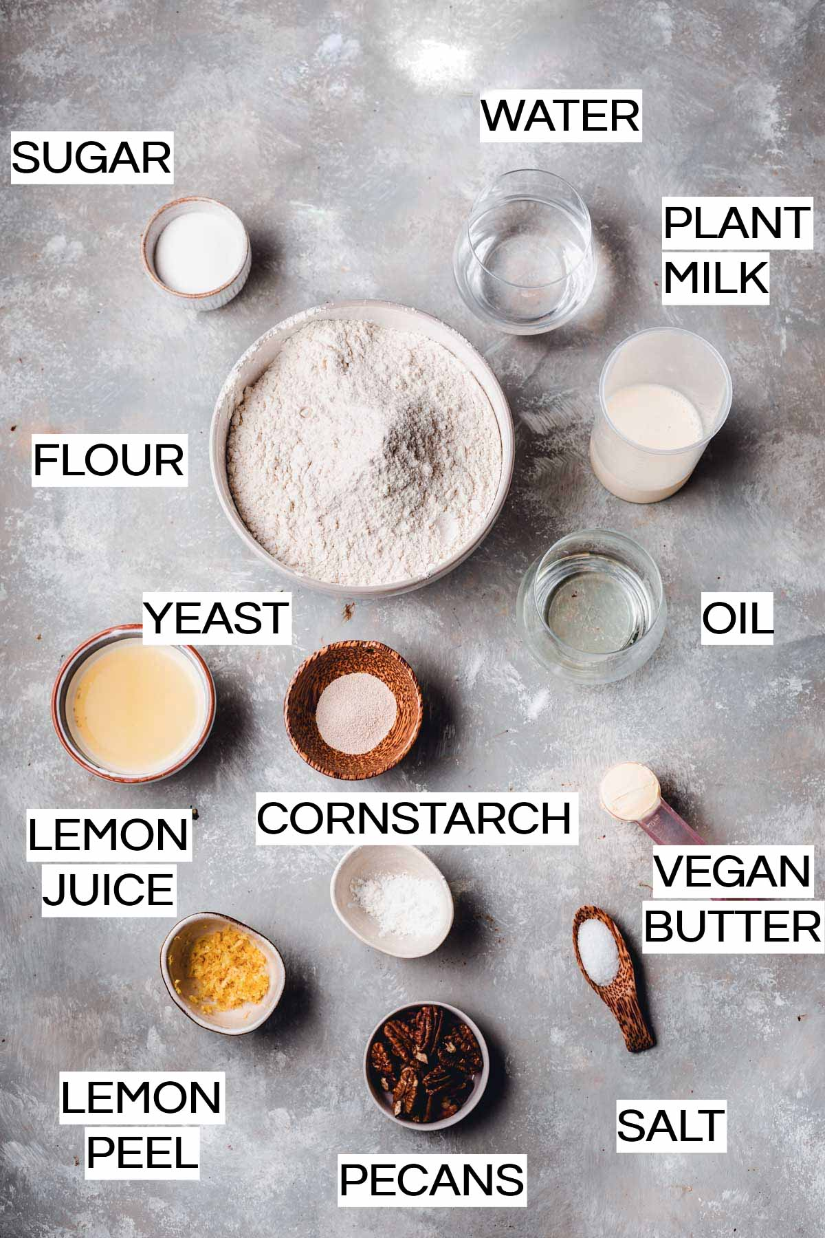 All the ingredients needed to bake vegan rolls laid out on a flat surface
