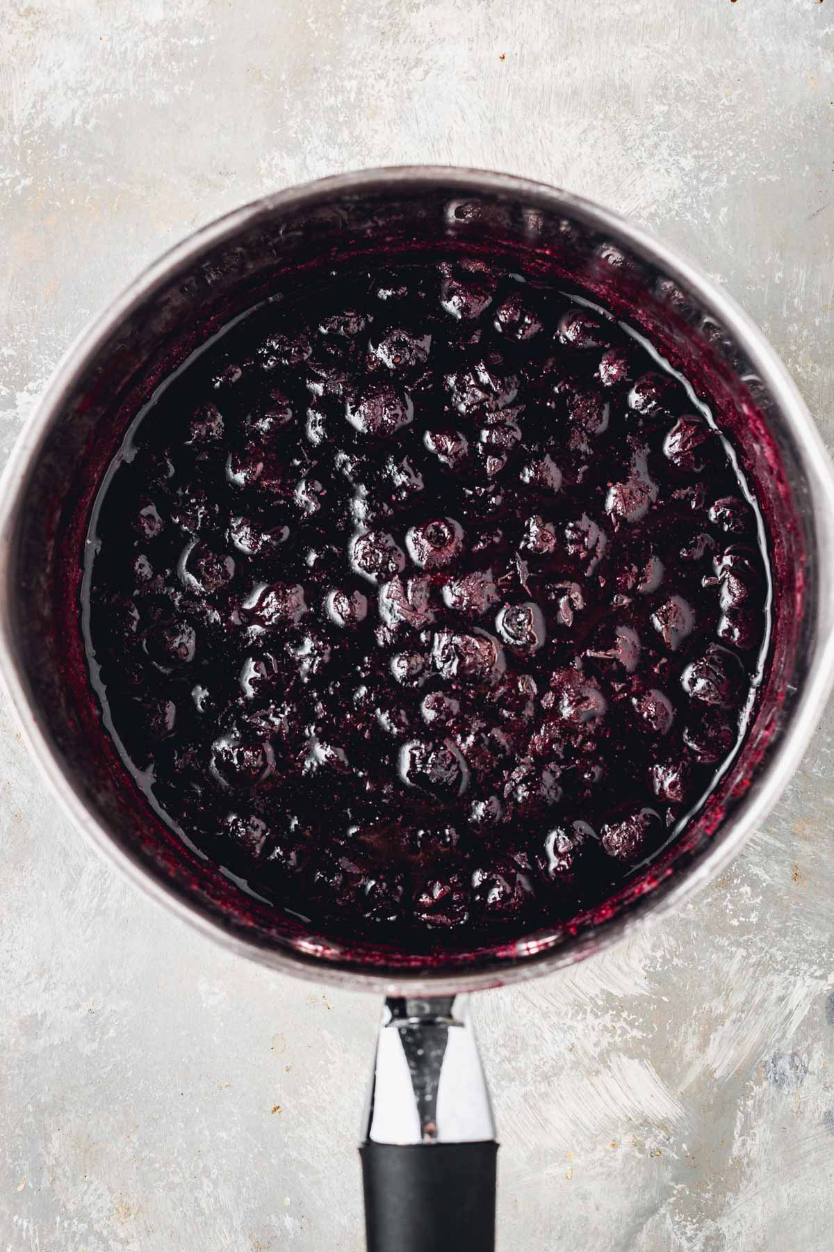 An overhead view of a small pan filled with blueberries.