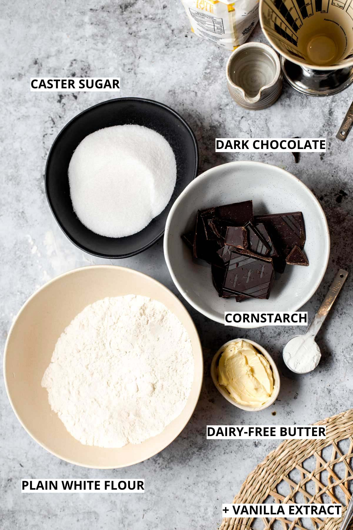 The ingredients needed to bake vegan shortbread cookies.