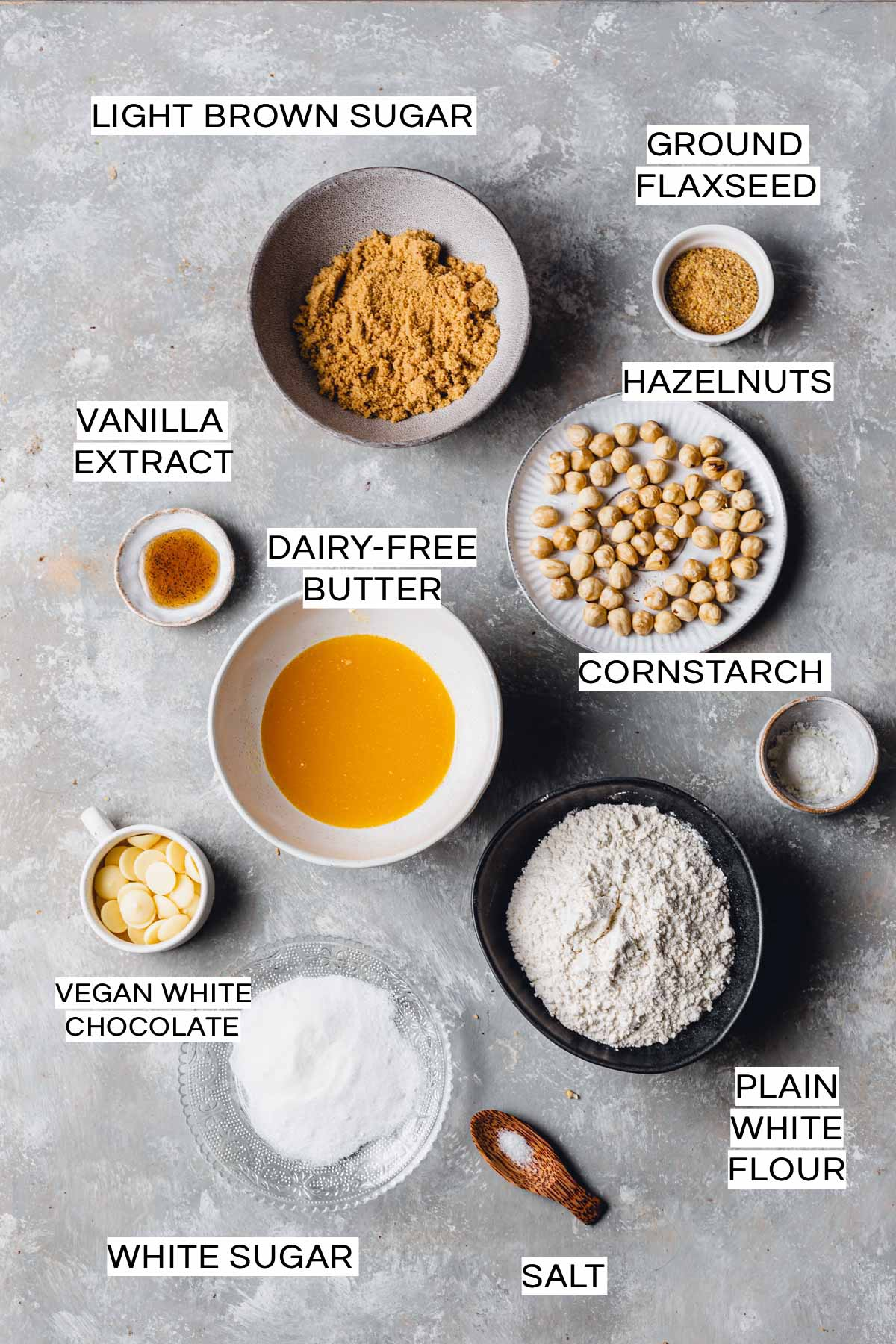 An overhead view of all ingredients needed to bake a blondie laid on a flat grey surface
