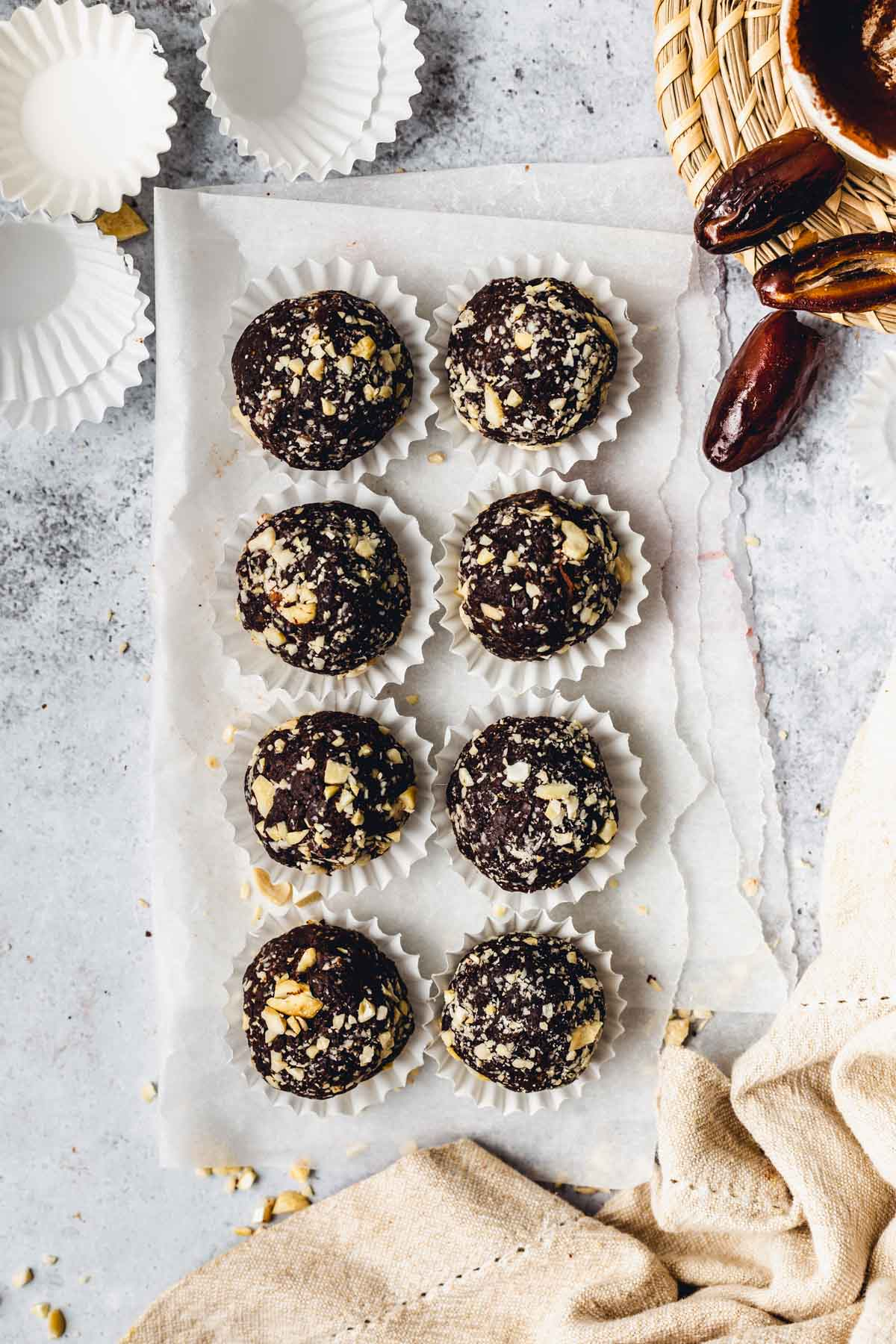 Bliss balls placed on a piece of parchment paper.