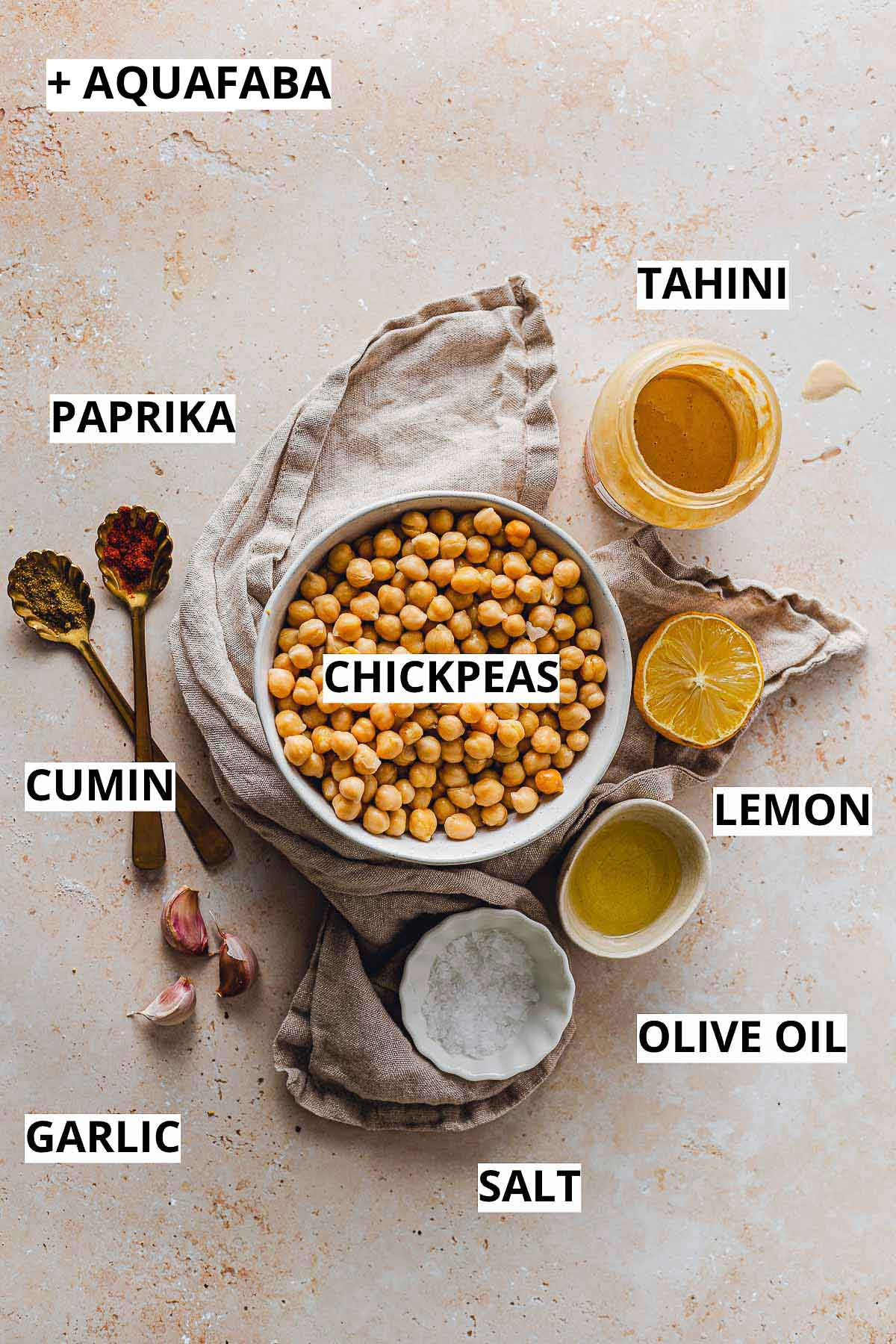 All the ingredients needed to make tahini laid out on a flat surface.