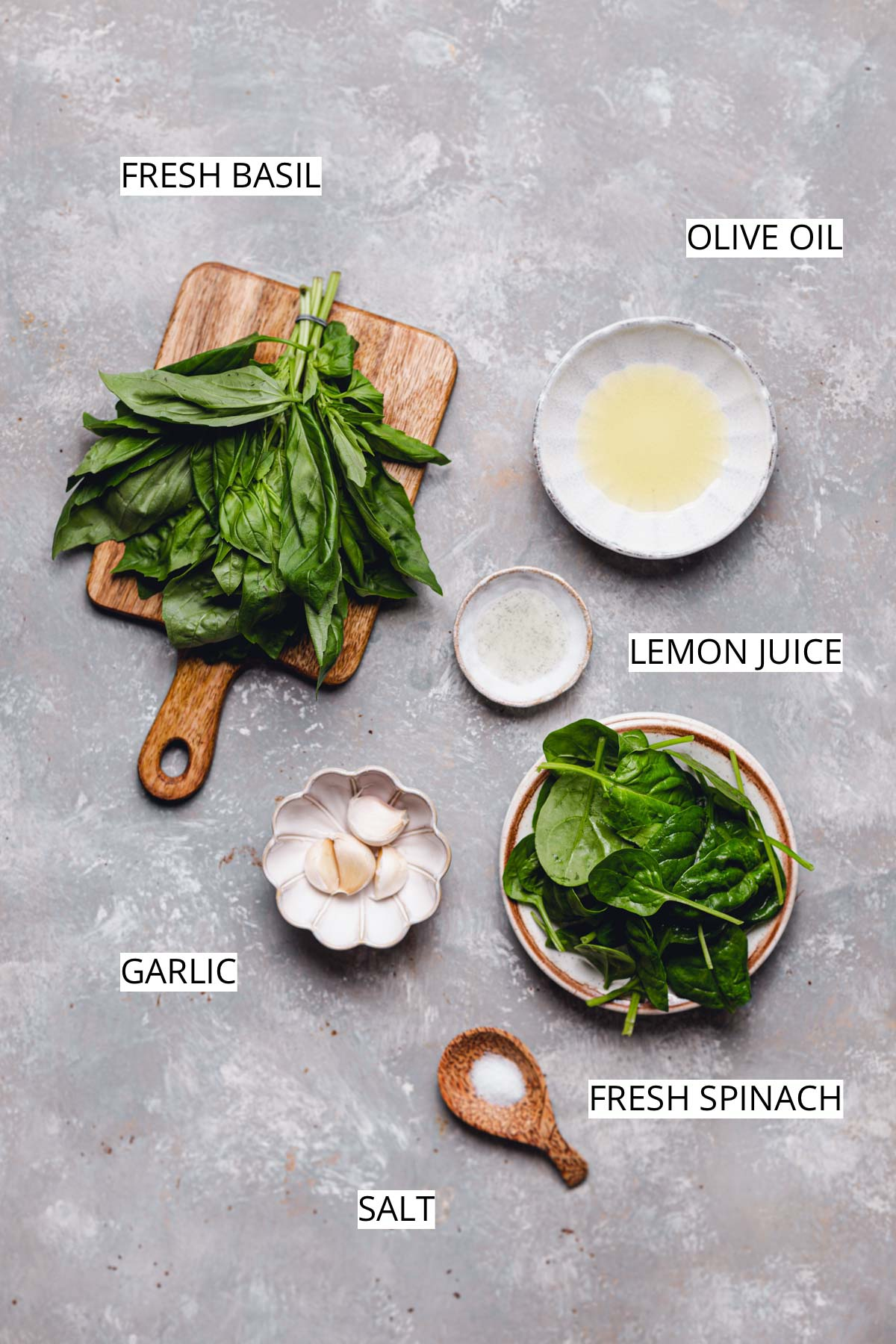 The 5 ingredients needed to make vegan pizza sauce laid out on a flat background.